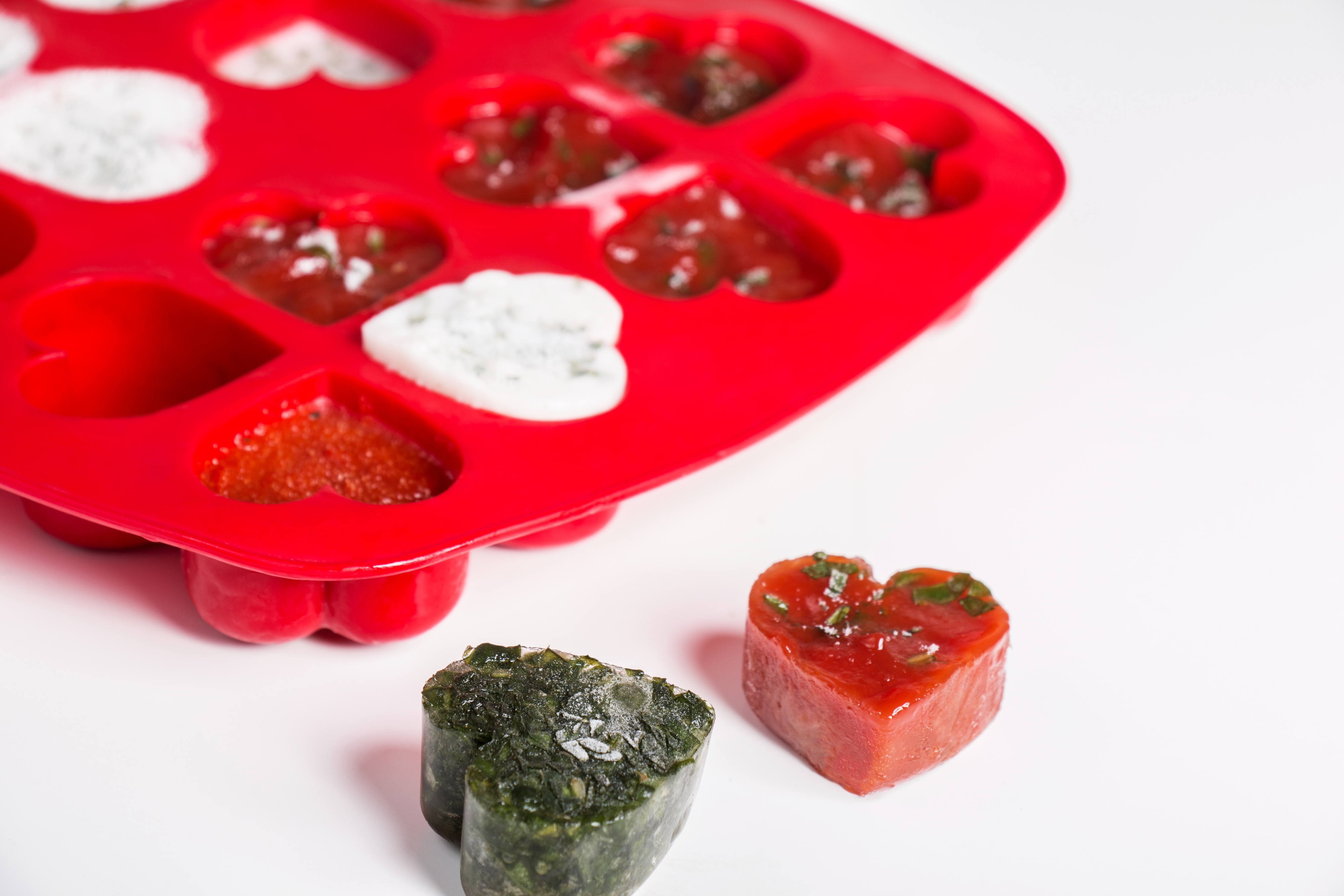 frozen sauces and herbs in ice cube trays